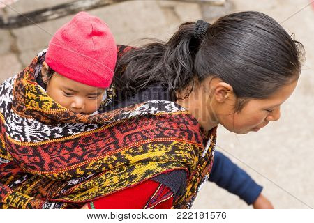 San Juan Ostuncalco, Guatemala - June 24: An Unidentified Baby Carried In A Traditional Woven Materi