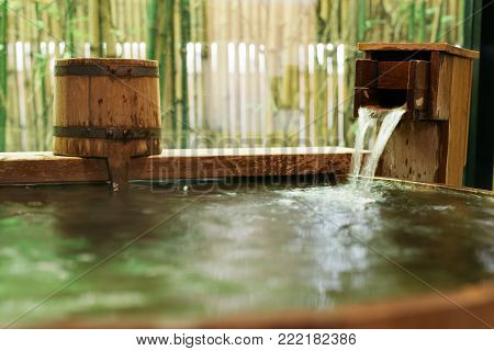 Onsen Series: Water Streaming Into Wooden Bathtub