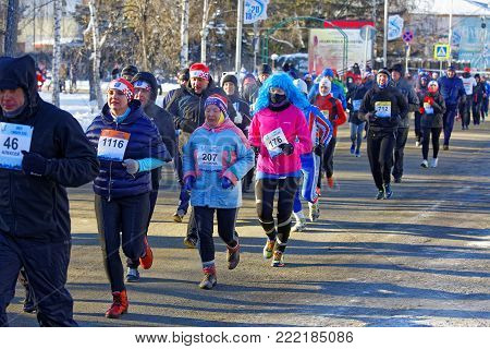 Editorial. Omsk, Russia - January, 07 2018. 27 th Christmas winter half marathon. Athletes dressed in different costumes running down Partyzanskaya street