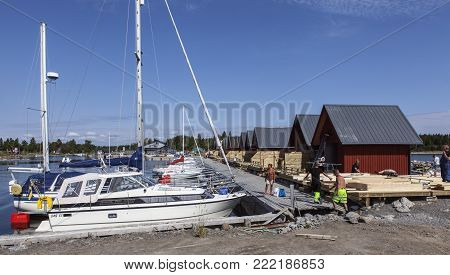 UMEA, SWEDEN ON JULY 27. View of a bridge close to the sea on July 27, 2017 in Rovagen, Sweden. Unidentified worker at the marina. Boats. Editorial use.