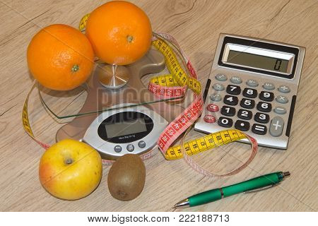 Concept of diet. Low-calorie vegetables diet. Diet for weight loss. Measuring tape and vegetables on the table. The idea of healthy diet