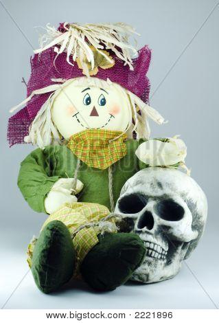 Scarecrow Huging Human Skull