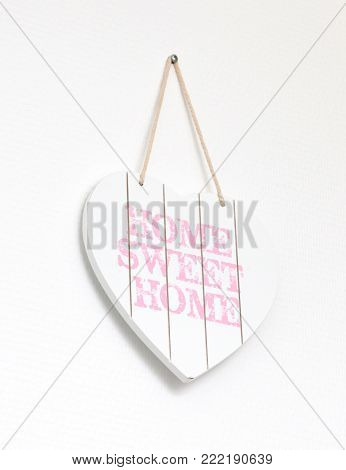 Text Home Sweet Home In A Heart-shaped Signboard