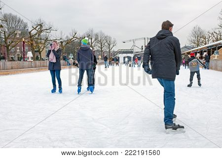 AMSTERDAM, NETHERLANDS - JANUARY 9, 2018: Ice skating on the ice skating rink at the Rijksmuseum in Amsterdam in the Netherlands on 9th january 2018