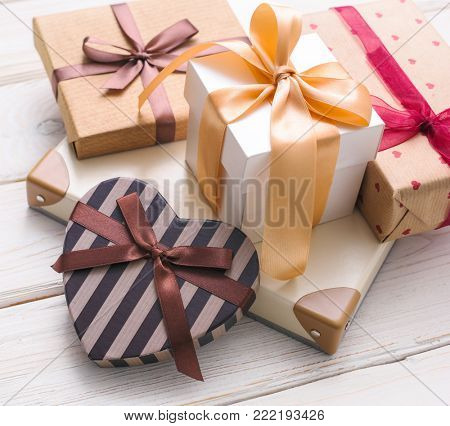 Many gift boxes on white wooden table