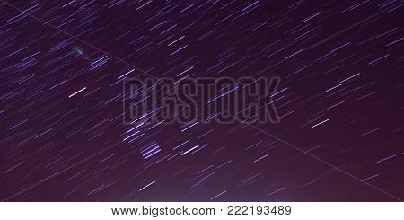 The movement of the star trails in the night sky, purple night sky