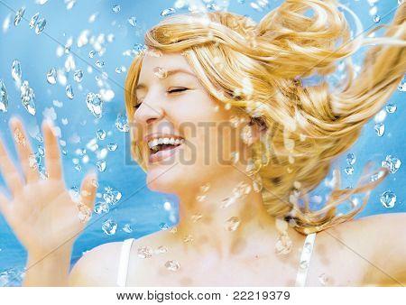 Young blond woman enjoying water