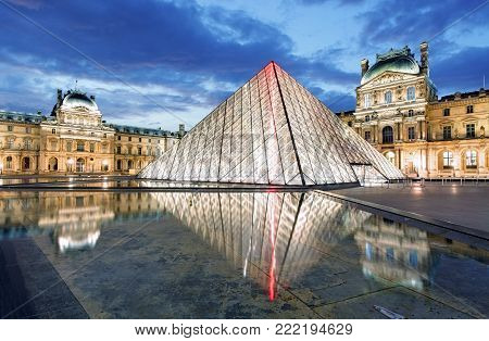 PARIS - FEB 9 : Louvre museum at twilight in summer on February 9,2015. Louvre museum is one of the world's largest museums with more than 8 million visitors each year.