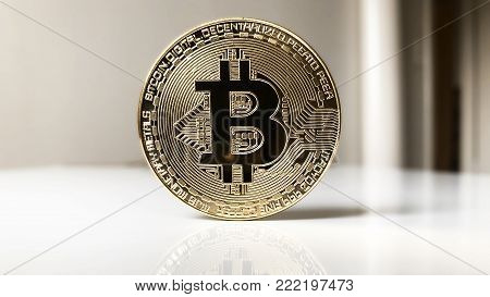 bitcoin cryptocurrency concept, physical copper coin in 16:9 banner or header format