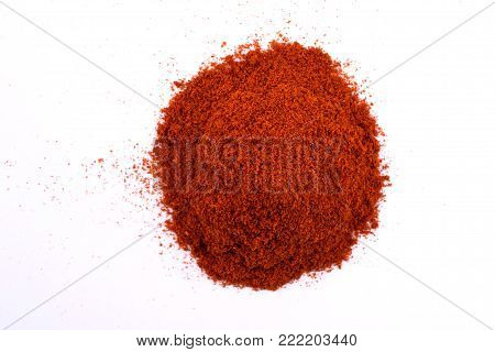 A pile of a  dry red paprika powder isolated on white background