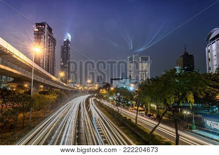 Long-exposure At Night Over A Road In Bangkok Thailand.