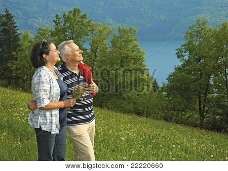 Attractive married mature couple enjoying togetherness.