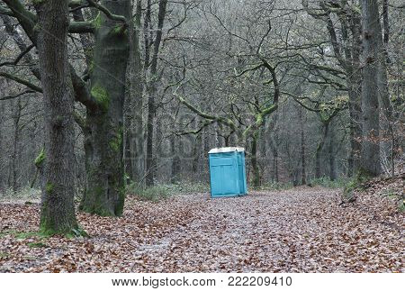 portable toilet in the middle of winter forest in the netherlands