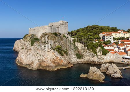 View of Fort Lovrijenac (St. Lawrence Fortress) on a steep cliff and other buildings in Dubrovnik, Croatia.
