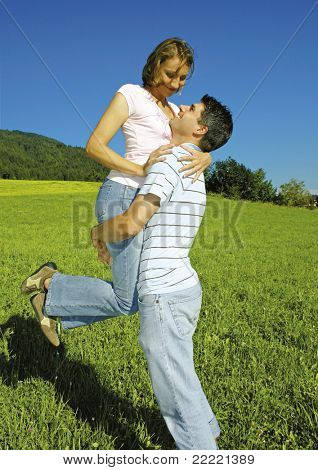 playful couple in the nature on a summerday. keyword for this collection is married77
