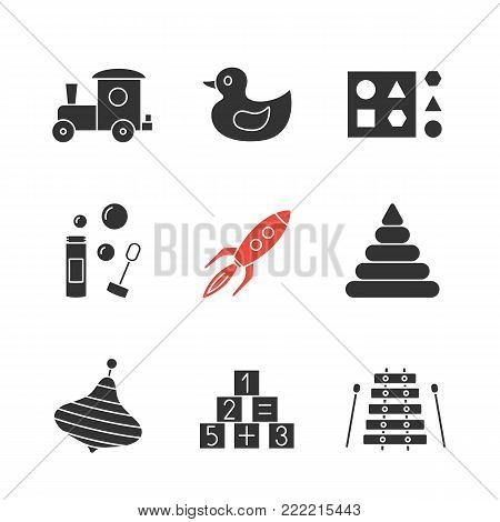 Kids toys glyph icons set. Silhouette symbols. Train, rubber duck, shape sorter toy, bubble blower, rocket, pyramid, humming top, math blocks, xylophone. Vector isolated illustration