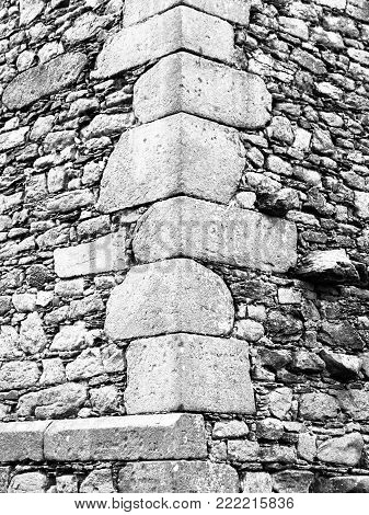 Construction detail of corner wall of old historical castle or ruin. Vintage architecture.
