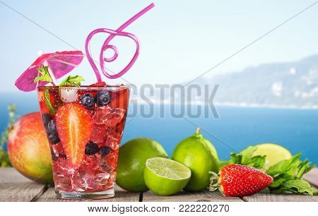 Glass cocktail strawberries table bar color background
