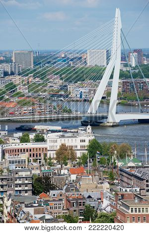 ROTTERDAM, NETHERLANDS - JUNE 02, 2013: Aerial view to Erasmus bridge and modern buildings of the city of Rotterdam, Netherlands.