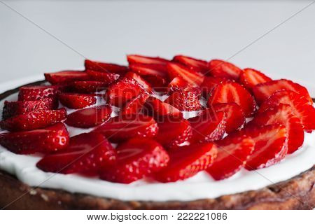 Traditional strawberry pie or tart, cake sweet pastry. classic American food on rustic table background. eating with a custard cream. close up, rustic style, copy space. Homemade Fresh baked delicious