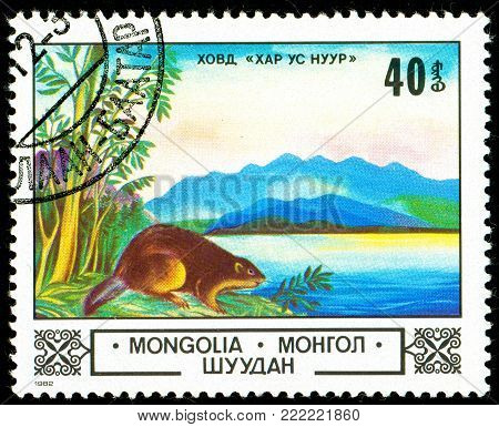 Ukraine - circa 2018: A postage stamp printed in Mongolia show Eurasian Beaver or Castor fiber in Char Us Lake. Series: Animals and landscapes. Circa 1982.