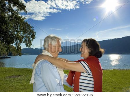 attractive married mature couple enjoying the sunset. keyword for this collection is