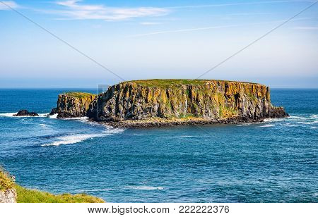 The Sheep Island near Ballintoy, Carrick-a-Rede and Giant's Causeway, North Antrim Coast, County Antrim, Northern Ireland, UK