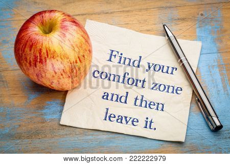 Find your comfort zome and then leave it - inspirational handwriting on a napkin with a fresh apple