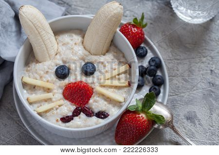 Funny bunny oatmeal bowl with fruits, for kids healthy breakfast