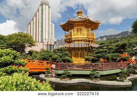Pond, bridge and Pavilion of Absolute Perfection at the Nan Lian Garden in Hong Kong, China.