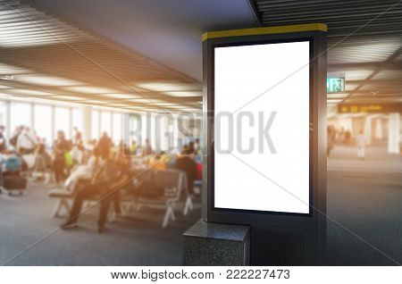 vertical blank advertising billboard or light box showcase with people waiting at airport, copy space for your text message or media content, advertisement, commercial and marketing concept