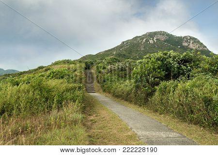 Ling Kok Shan hill and paved footpath at the Lamma Island in Hong Kong, China.