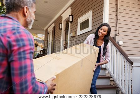 Couple Carrying Big Box Purchase Into House