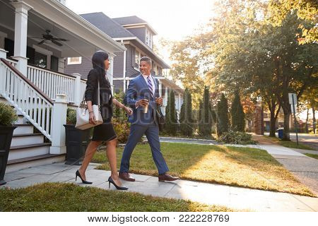 Business Couple Leaving Suburban House For Commute To Work poster