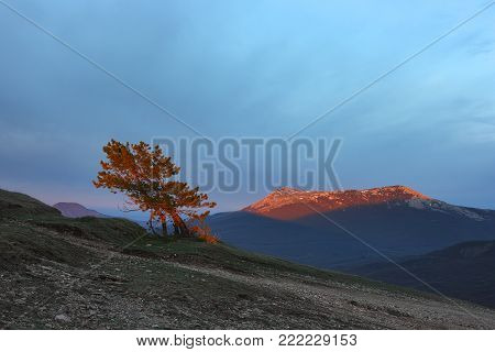 Crimean landscape in morning. The peak of Chatyr-Dag mountain in the rays of the rising sun. This mountain is a symbolic significance for the history of the Crimean peninsula.