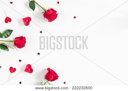Flowers composition. Frame made of rose flowers, confetti on white background. Valentine's Day background. Flat lay, top view, copy space