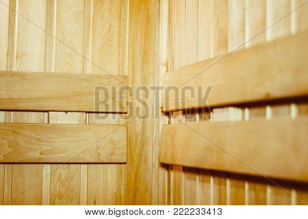 The interior of the sauna - shelves, window, lamp, nobody