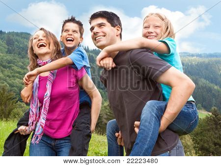 cute family having fun in the nature