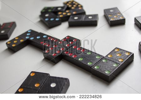 Black with colorful dots on white table