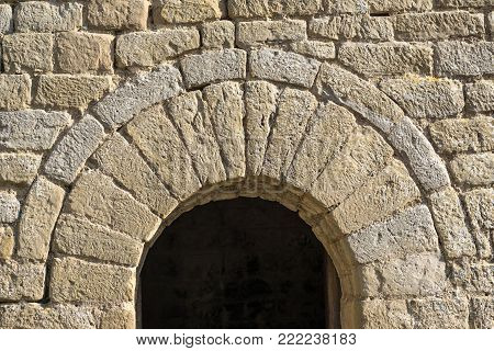 semicircular arch at the entrance of a small chapel Romanesque architecture style. half-point arch