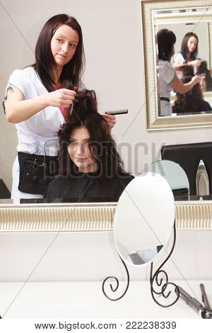 Brunette Woman Dying Hair By Hairstylist. In Hairdressing Studio.