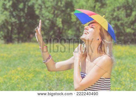 Lgbt Discrimination - Girl Posing With A Multicolored Umbrella In Nature.