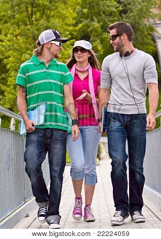 three students on the campus