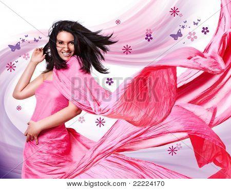 mooi meisje met een roze jurk en vliegende haren