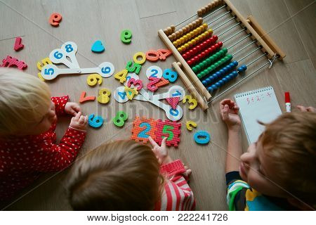 little boy and girls learning numbers, abacus calculation