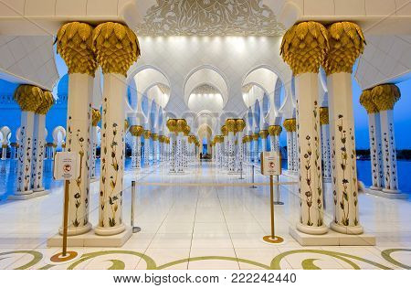 ABU DHABI, UNITED ARAB EMIRATES - DEC 31, 2017: Part of the interior of the Sheikh Zayed Mosque in Abu Dhabi in twilight. It is the largest mosque in the country.