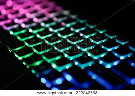 Back lighted computer gaming keyboard with versatile color schemes.