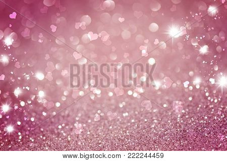 pink white glittering Christmas lights. Blurred abstract background with flying hearts, Valentine's day wallpaper