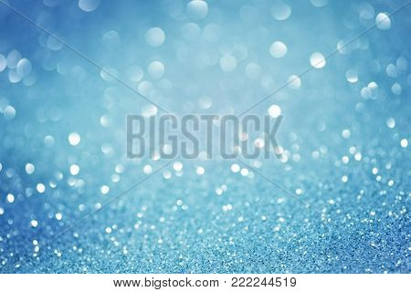 blue glittering christmas lights. Blurred abstract festive background