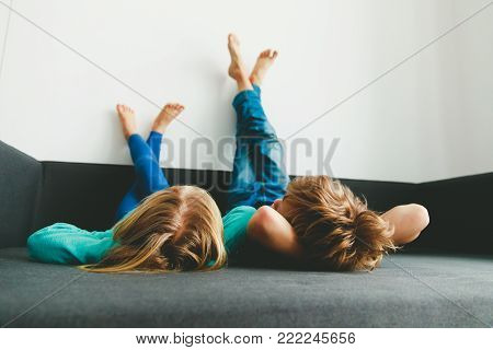 little boy and girl relax at home - home comfort and laziness